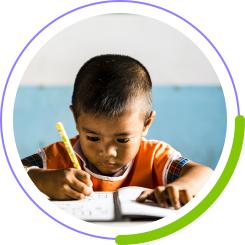 little boy working in a notebook