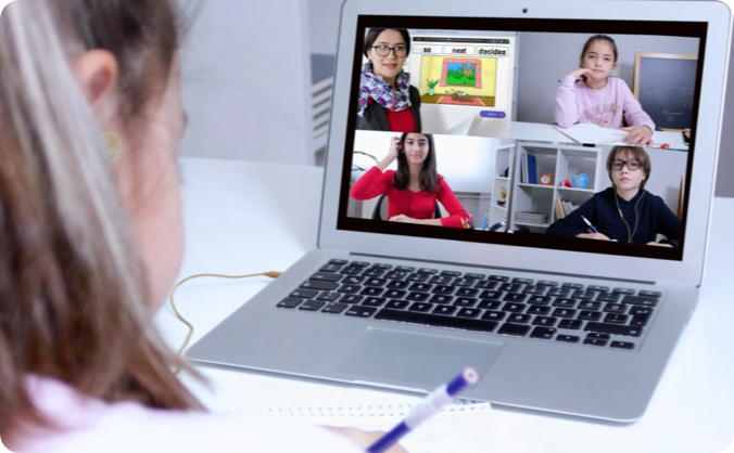 Picture of a woman helping students in a zoom